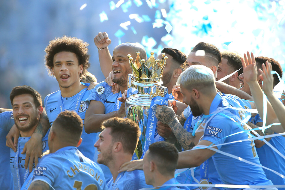 BRIGHTON, ENGLAND - MAY 12: Vincent Kompany of Manchester City lifts the Premier League Trophy after winning the title during the Premier League match between Brighton & Hove Albion and Manchester City at American Express Community Stadium on May 12, 2019 in Brighton, United Kingdom. (Photo by Tom Flathers/Man City via Getty Images)
