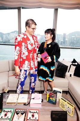Josie Ho showcases special edition handbag alongside current brand founder Grégory Bernard. (CNW Group/Niki Inc)
