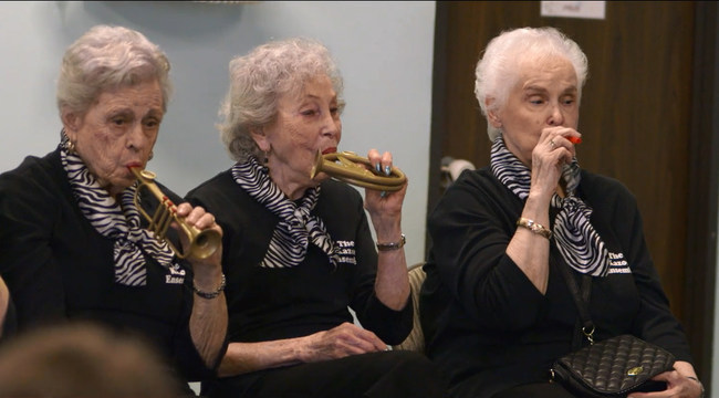 Naomi Friedman and fellow members of the Kazoo Ensemble performing at a local day care facility.