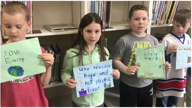 Grade two students from St. John XXIII share their energy saving tips in the Video Challenge component of the Classroom Energy Diet Challenge. (CNW Group/Royal Canadian Geographical Society)