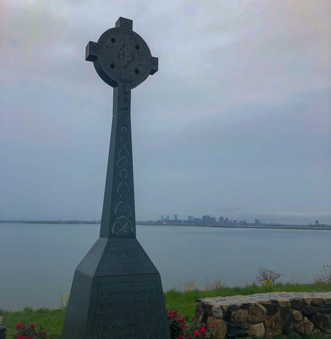 The hand engraved celtic cross overlooking Boston Harbor has been erected and awaits the blessing and dedication ceremony later this month.