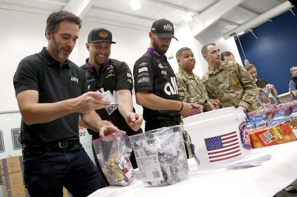 Driving legend Jimmie Johnson joins volunteers from Ally, his race team and the USO to build care packages for service members.