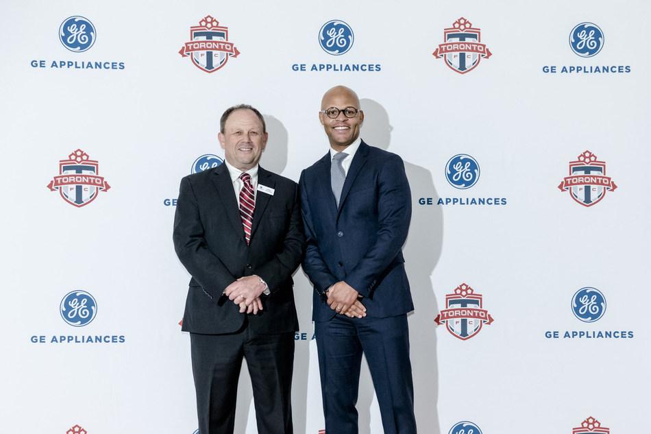 GE Appliances President, Mike McCrea and Toronto FC General Manager, Ali Curtis celebrate the announcement of a multi-year partnership between the brand and club. The deal, which takes affect today, will include a number of exciting activations and opportunities. (CNW Group/GE Appliances Canada)