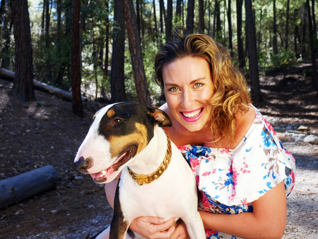 Dr. Anna Marie Blessing, PhD with Tucson Biofeedback's Therapy Dog Pepe.