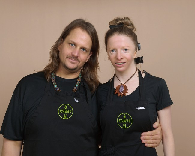 Thane and Cynthia in Assuaged Celebrity Chef Aprons