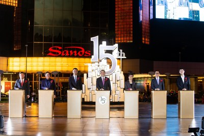 Guests of honour officiate the 15th anniversary celebration for Sands Macao Thursday at the hotel and entertainment complex's outdoor fountain.
