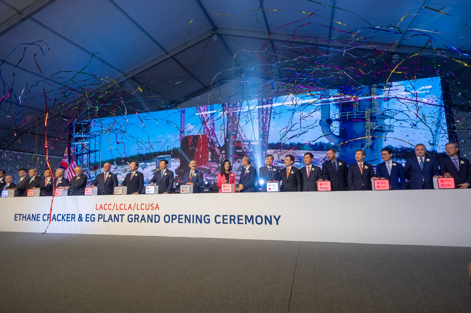 Government and company representative complete the grand opening celebration ceremony.