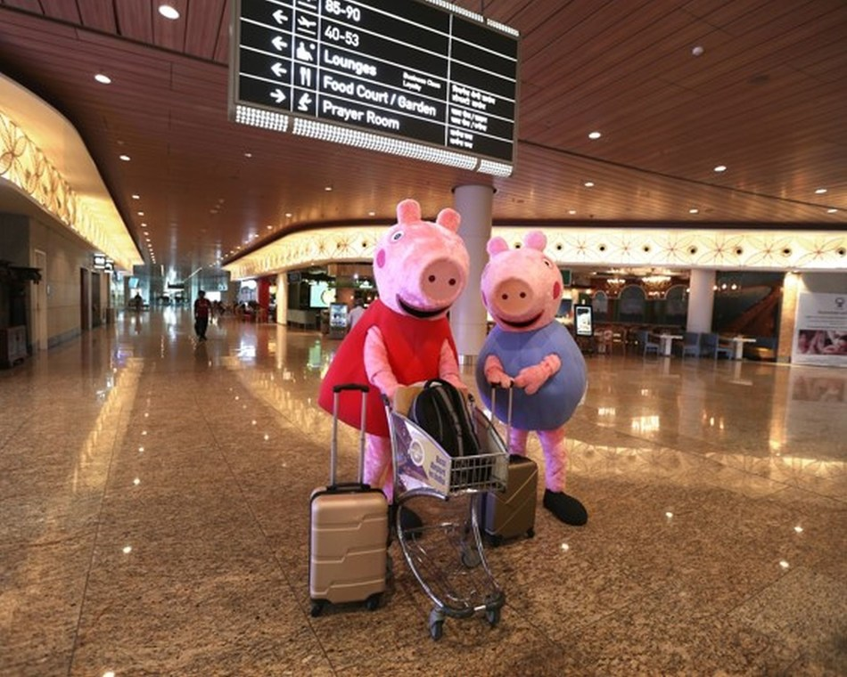 Peppa Pig along with her brother George land in India, surprising kids and adults at the airport (PRNewsfoto/Entertainment One)