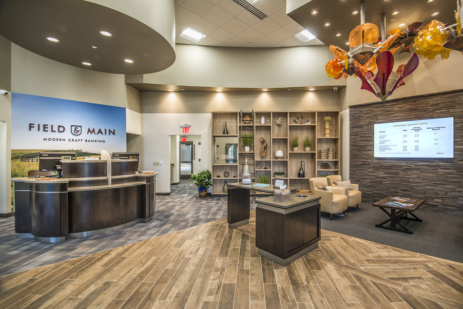 The contemporary Field & Main Bank in Lexington, Ky., uses fully equipped freestanding service desks in place of a traditional teller counter, facilitating more direct and seamless interactions with clients. Freestanding service desks, or teller pods, enable relationship bankers to interact more directly with customers and demonstrate electronic services on computers and mobile devices.