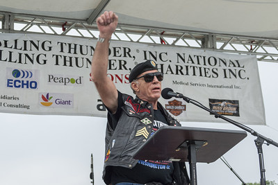 Sgt. Artie Muller speaking to the crowd at the Reflecting Pool stage during Rolling Thunder XXX - photograph by Lee Stalsworth