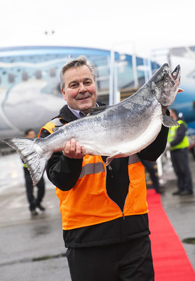 Jim Kostka from Copper River Seafoods holds up the ceremonial first fish