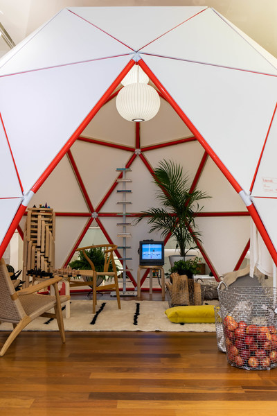 Dome Life is an homage to the geodesic dome. Dome Home (shown) houses a uniform of essential white basics from Entireworld as well as classics from Hans Wegner, George Nelson and Alvar Aalto alongside a Buckminster Fuller library. Photo by Alexander Kusak.