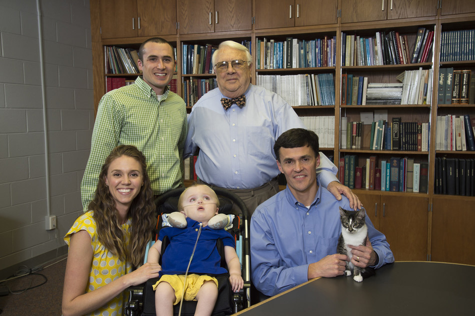 Auburn scientists developed a gene therapy treatment for GM1 gangliosidosis that is in clinical trials at the National Institutes of Health. Sara and Michael Heatherly of Opelika, Alabama, whose son Porter was the first known case of GM1 in Alabama and died in 2016, have been instrumental in bringing awareness to the disease. Pictured in a 2014 photo are Sara and Porter Heatherly, Dr. Doug Martin, Michael Heatherly and Dr. Henry Baker, director emeritus of Auburn's Scott-Ritchey Research Center.