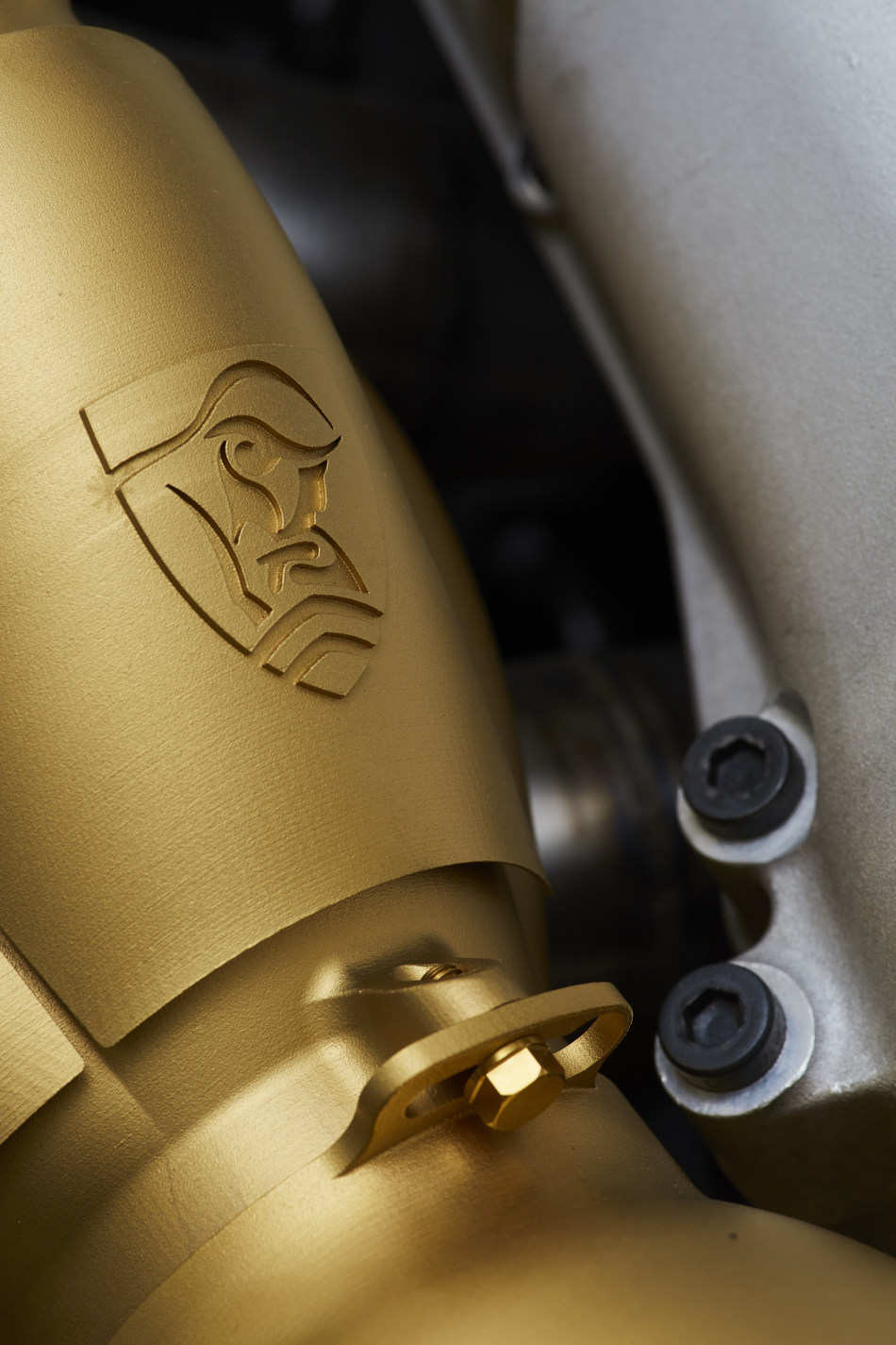 This FZed exhaust collector was 3D printed in titanium on 3D Systems' ProX DMP 320, and PVD coated in titanium nitride. (Image courtesy of Rodin Cars)