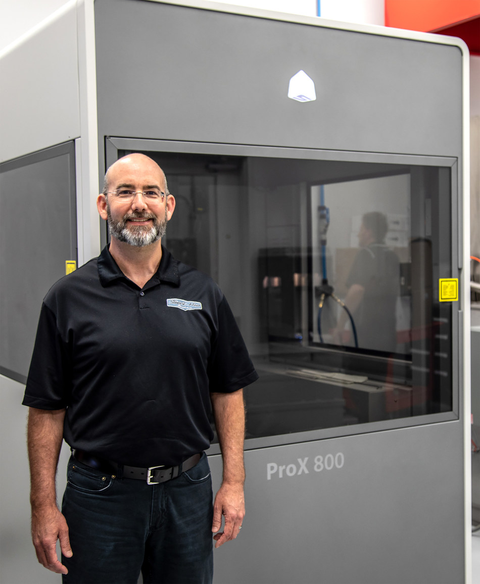 Reneau Van Landingham (pictured) and the team at Stewart-Haas Racing use 3D Systems' ProX 800 to produce aerodynamic components for race car component development and wind tunnel testing. (Image courtesy of Stewart-Haas Racing)