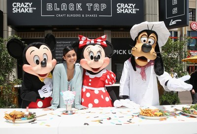 Mickey Mouse, Minnie Mouse and Goofy join actor Vanessa Hudgens to celebrate the opening of Black Tap Craft Burgers & Shakes, May 18, 2019, in the Downtown Disney District at Disneyland Resort in Anaheim, Calif. (Photo by Jesse Grant/Getty Images for Black Tap Craft Burgers and Shakes)