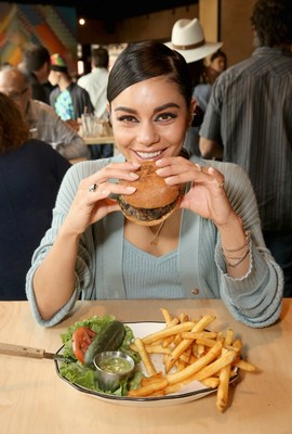 Actress Vanessa Hudgens enjoys a Vegan Burger at the opening celebration of Black Tap Craft Burgers & Shakes, May 18, 2019, in the Downtown Disney District at Disneyland Resort in Anaheim, Calif. (Photo by Jesse Grant/Getty Images for Black Tap Craft Burgers and Shakes)