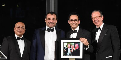 Asheesh Advani, JA Worldwide President and CEO, presents Omar K. Alghanim with award at JA Worldwide Centennial Gala, May 2, 2019