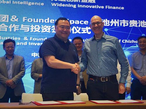 Left: Dr. Bruno Wu, Chairman of Ideanomics. Right: Steve Hoffman (Captain Hoff), CEO of Founders Space (PRNewsfoto/Sun Seven Stars)