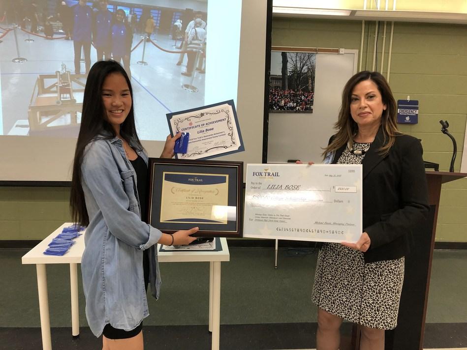 Lilia accepting her Fox Trail Senior Living scholarship award.