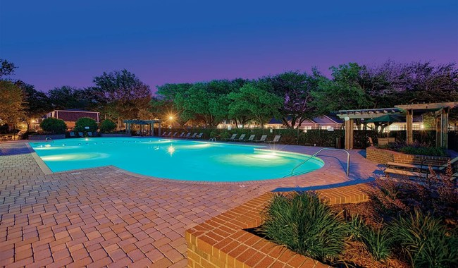 The townhome community is rich with amenities such as this large, resort-style pool and its adjacent hot tub.