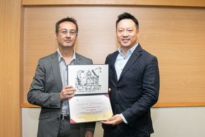 Prof. Aristotelis Stouraitis, Head, Department of Finance and Decision Sciences, Hong Kong Baptist University  (left) presented Jason Lau, Chief Information Security Officer, Crypto.com with an appointment certificate for his adjunct professorship and seat on HKBU's advisory board.