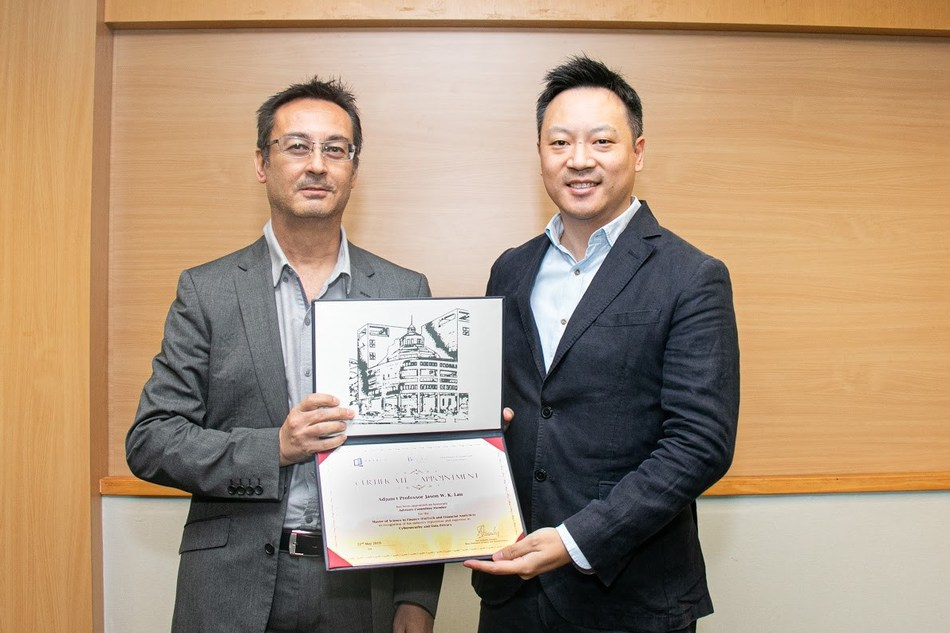 Prof. Aristotelis Stouraitis, Head, Department of Finance and Decision Sciences, Hong Kong Baptist University  (left) presented Jason Lau, Chief Information Security Officer, Crypto.com with an appointment certificate for his adjunct professorship and seat on HKBU's advisory board. (PRNewsfoto/Crypto.com)