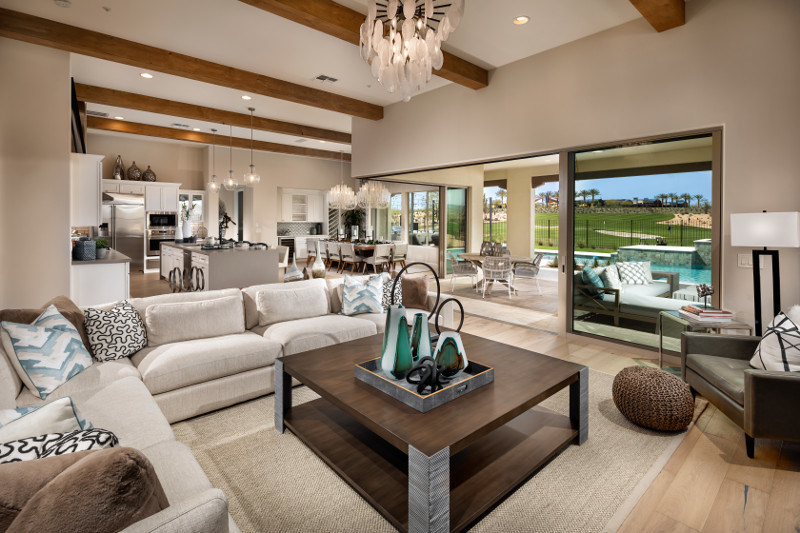 The Dorado features an open layout with floor-to-ceiling rolling glass doors overlooking the backyard at Trilogy at Verde River.