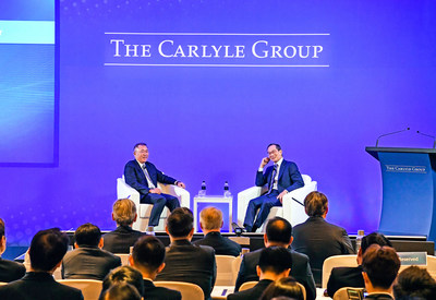Hyundai Motor Group Executive Vice Chairman Euisun Chung (left) speaks in a fireside chat with The Carlyle Group's Co-CEO Kewsong Lee (right) at a conference in Seoul