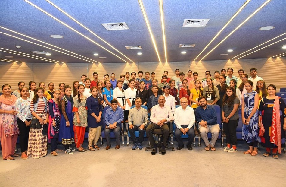 Students with Shri Govind Dholakia while their visit at SRK Exports (PRNewsfoto/SRK Knowledge Foundation)