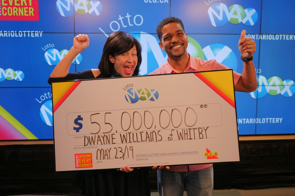 OLG's VP Channel Management, Debora Hume, celebrates a $55 million win with Dwayne Williams from Whitby. Dwayne won the April 5, 2019 LOTTO MAX jackpot. (CNW Group/OLG Winners)