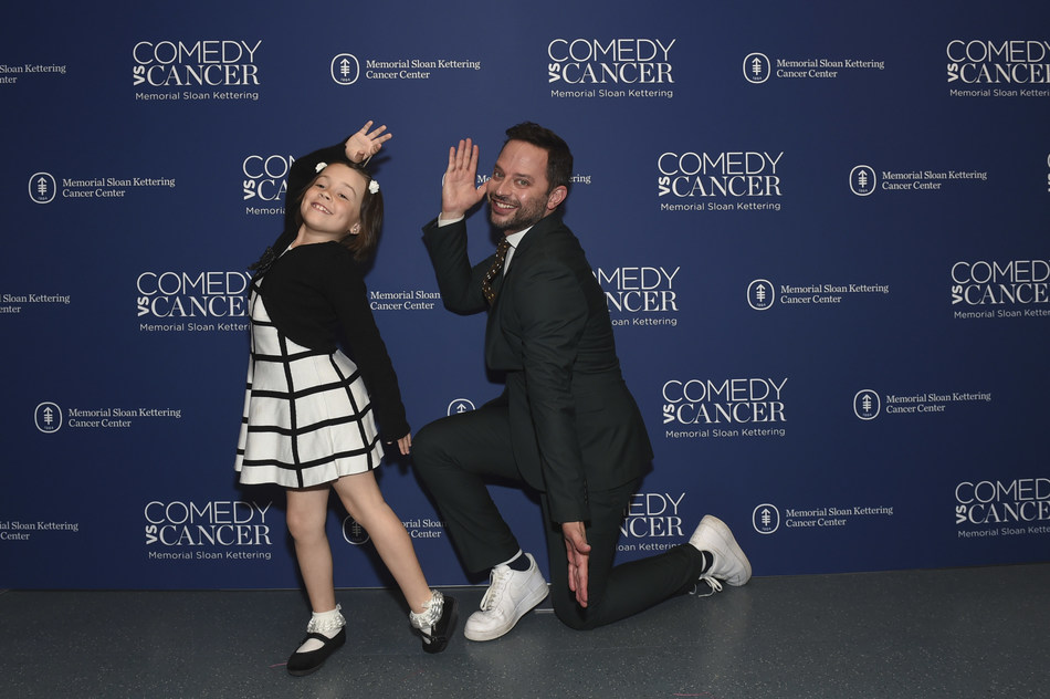 Audrey Lorenz shows Nick Kroll how to pose for photos at Memorial Sloan Kettering's Comedy vs Cancer event on Tuesday, May 14, 2019 in New York City. Lorenz, an 8-year-old cancer survivor, opened the show with her comedy routine before introducing Kroll to the audience.