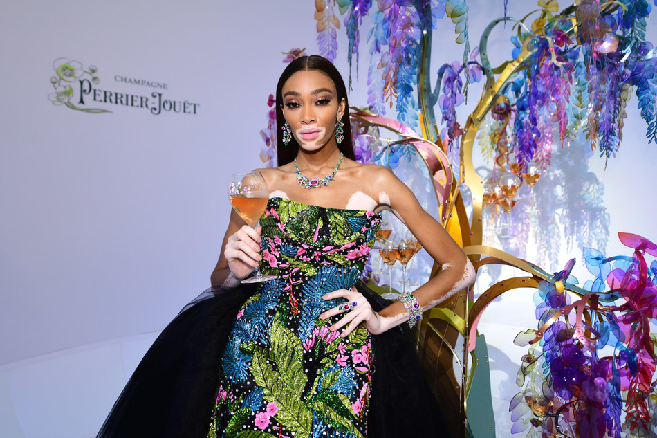 Winnie Harlow in front of the Perrier-Jouët tree designed by Bethan Laura Wood