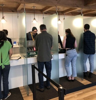 First adult use cannabis customers make their purchases at Garden Remedies in Newton today, Saturday, May 25, 2019.