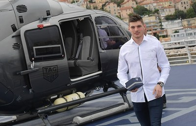 Rising star of the Aston Martin Red Bull Racing Team Max Verstappen kicks off the Monaco Grand Prix weekend by delivering the first of five new Monaco collector timepieces, 1969-1979 Limited Edition by helicopter to celebrate the 50th anniversary of the iconic watch.
