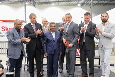 Chicago Mayor Lori Lightfoot and Skender CEO Mark Skender cut the ribbon to officially open Skender's manufacturing facility on the southwest side of Chicago, which will produce modular affordable housing for the city. Pictured left to right: 27th Ward Alderman Walter Burnett; Gary Perinar, Chicago Regional Council of Carpenters; 22nd Ward Alderman Michael Rodriguez; Mayor Lightfoot; Pete Murray, Skender; Mark Skender; Andy Gloor, Sterling Bay; Tim Swanson, Skender.