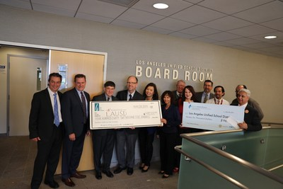 Representatives from SoCalGas, Metropolitan Water District and LADWP present rebate checks to Los Angeles Unified School District on May 28, 2019