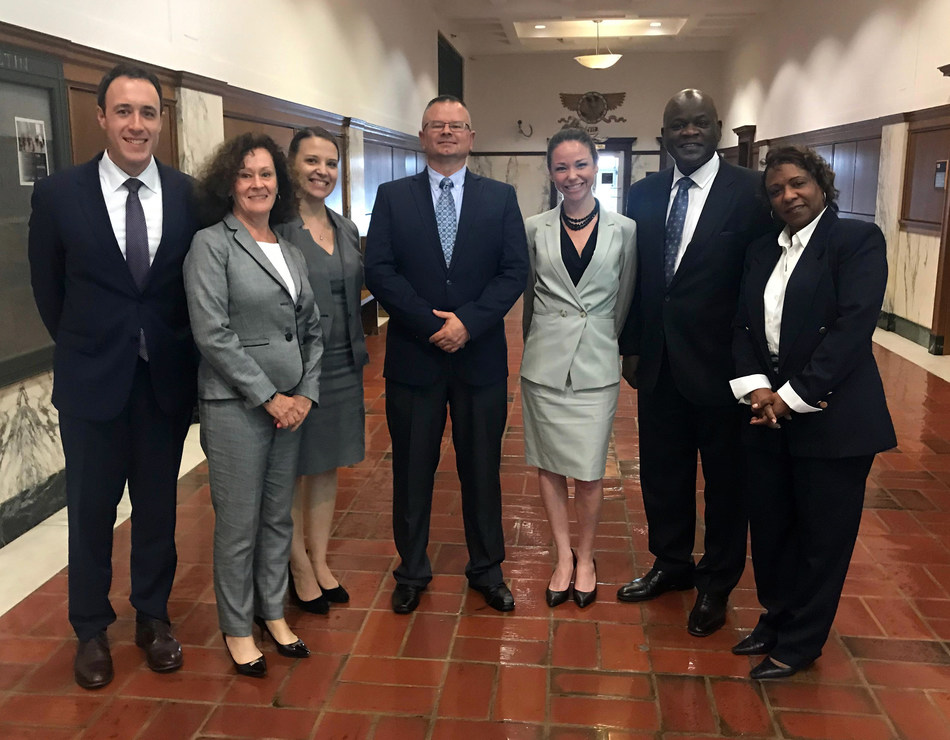 """America Can! Cars For Kids' Trial Team (l-r) Christopher Kinkade, Karen Confoy, Allision Hollows, Chief Operating Officer Malcolm Wentworth, Valerie Yanaros Wilde, Aubrey """"Nick"""" Pittman, and Sharie McEwing"""