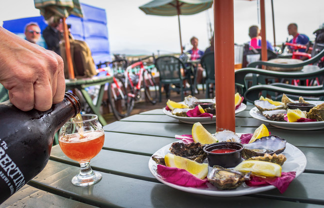 Enjoy Local Pacific Gold Morro Bay Oysters and local craft brew all summer long.