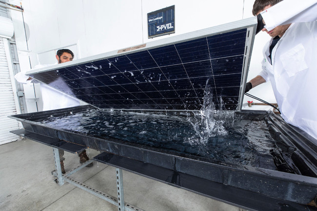 PVEL technicians conduct a wet leakage test on a solar PV module as part of PVEL's thermal cycling test sequence. Wet leakage is an important safety test. Source: PVEL LLC