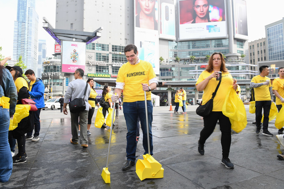 Toronto, May 30 – Peter Luongo, Managing Director, Rothmans, Benson & Hedges,  joins employees in Toronto's Yonge-Dundas Square for Cigarette Butt Clean-Up Day as part of  Unsmoke Canada Week and the company's commitment to a Smoke-Free Future. (CNW Group/Rothmans, Benson & Hedges Inc.)