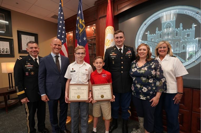 Photographed from left to right: GMC President LTG William Caldwell, NewDay USA Founder & CEO Rob Posner, students Joseph and Jacob Rousseau, parents James and Melinda Rousseau and GMC Prep Principal COL Pam Grant.