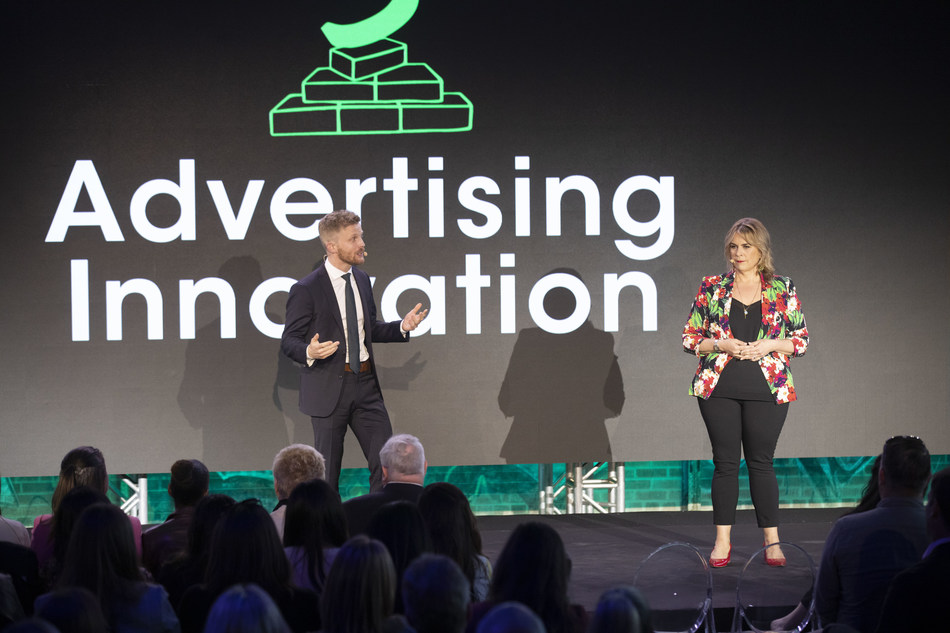 Barb McKergow, Corus' SVP of National Sales, and Spencer Charters, Corus' VP of Digital Data & Advanced Advertising, unveil advertising innovation at Corus's Upfront (CNW Group/Corus Entertainment Inc.)