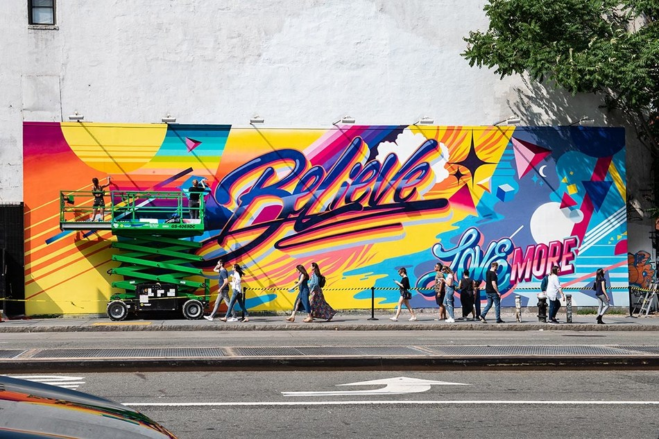 """Queen Andrea's """"Believe"""" mural will be on display on the iconic Houston Bowery Wall and adorn 300 Citi Bikes across New York City through October. Photo Credit: Martha Cooper"""