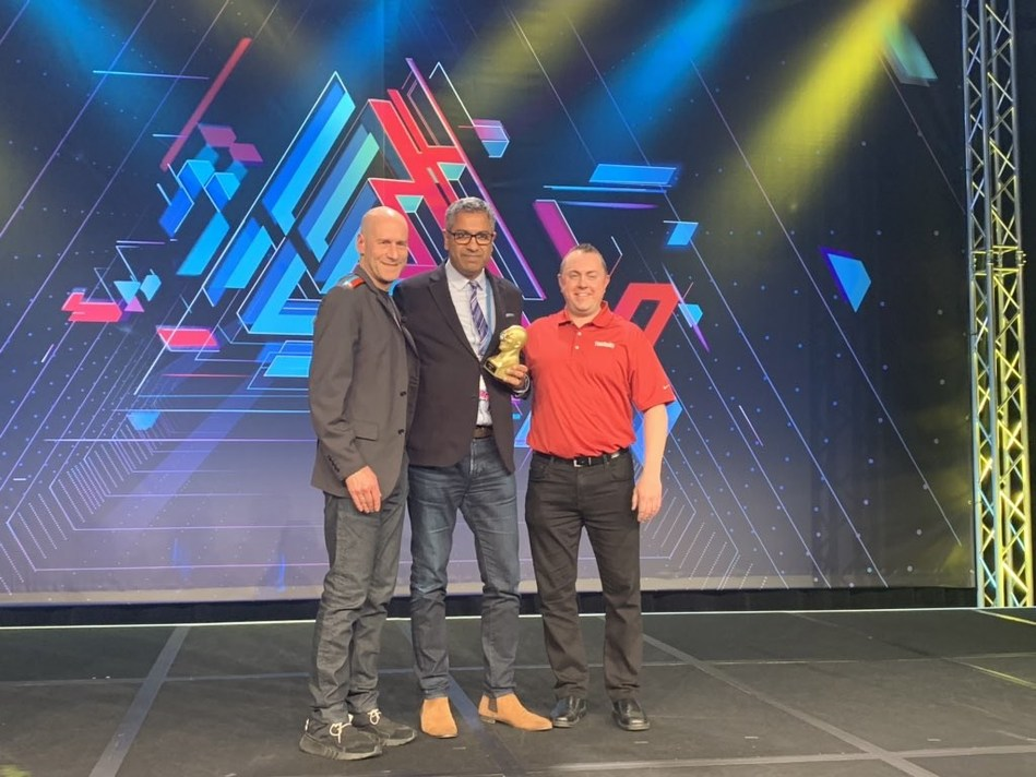 Atheer CEO Amar Dhaliwal (center) accepts AWE 2019 award for Best Enterprise Solution from Nathan Pettyjohn of the VR/AR Association (right) and Ori Inbar, co-founder and CEO of AugmentedReality.org and the producer of Augmented World Expo (left).