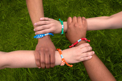 Tim Hortons® guests can donate $2 to receive a limited-edition red, blue, green or orange Camp Day bracelet. (CNW Group/Tim Hortons)