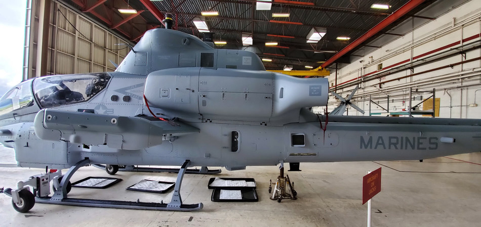 Marine Corps AH-1Z Viper helicopter is painted with one-component (1K) camouflage gray polysiloxane topcoat on the exterior. U.S. Naval Research Laboratory chemists developed the new topcoat for DoD aircraft, which is safer for the environment and easier to apply. (U.S. Naval Research Laboratory)