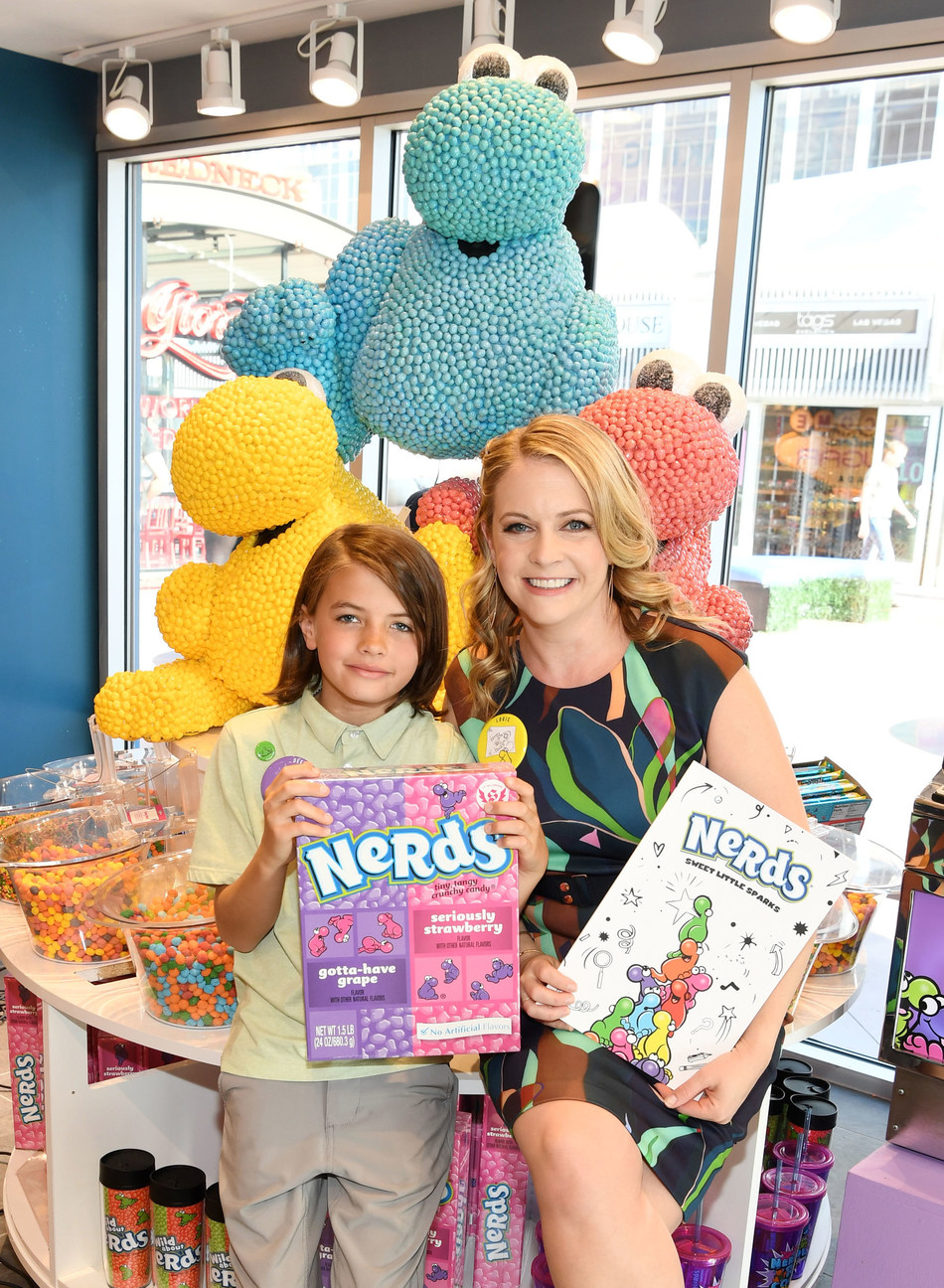 Melissa Joan Hart and son Braydon Hart Wilkerson celebrate being a NERD and the childhood favorite NERDS candy at the grand opening celebration of IT'SUGAR in Las Vegas, NV