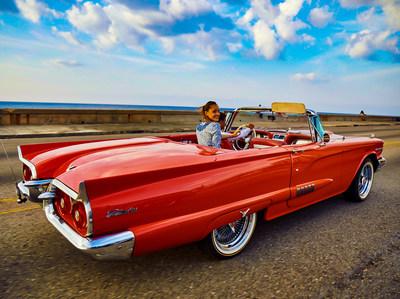 Classic car along El Malecón in Havana | Photo by CUBA CANDELA