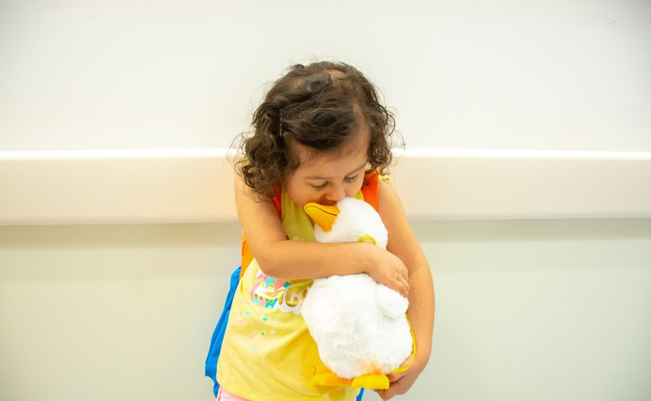 Sophia Zuniga, a three-year old cancer patient, kisses her new My Special Aflac Duck, a robotic companion designed to comfort her and other pediatric cancer patients throughout their treatment, after receiving this special gift at CHOC Children's Hospital in Orange, Calif. on Wednesday, June 5, 2019.